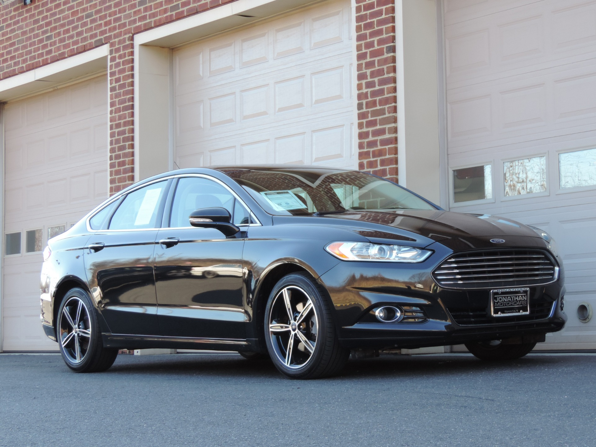 2015 ford fusion titanium the 2015 ford fusion titanium wards off asian midsize cars car. Black Bedroom Furniture Sets. Home Design Ideas